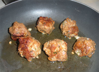 Frying up some delicious vegetarian meatballs.